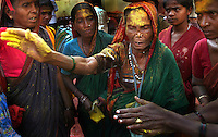 An older Devadasi acts as a medium between Yellamma and her worshippers during a session at the Yellamma Jatre in Saundatti, India.  The Jogati enters a trance-like state and devotees watch in awe as Yellamma begins to speak through her. The medium cries out, shakes uncontrollably and often collapses in exhaustion at the end of the session. This provides worshippers more direct contact with Yellamma and the woman is duly compensated.  These mediums are central to perpetuating the rituals of Yellamma and recruiting Devadasi, particularly during the time of the Jatre. .