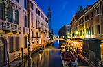 A beautiful evening on a canal in the sestiere of Castello in Venice, Italy.