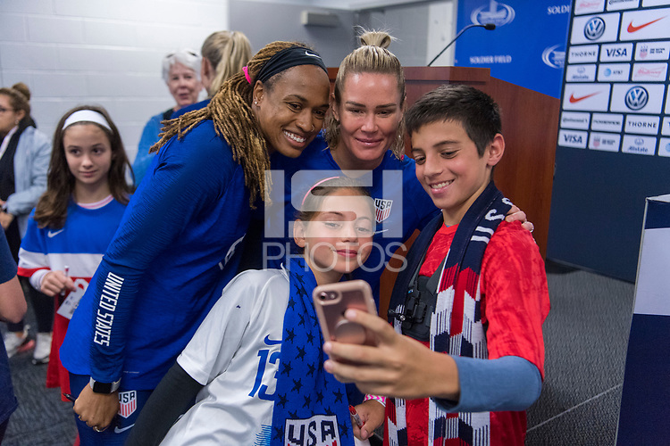 CHICAGO, IL - OCTOBER 5: Jess McDonald #22 and Ashlyn Harris #18 of the United States take a picture with fans at a kid's press conference at Soldier Field on October 5, 2019 in Chicago, Illinois.