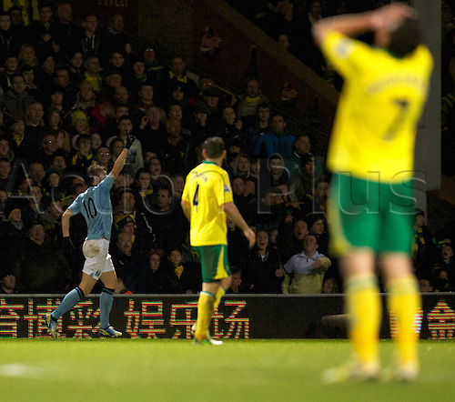 29.12.2012 Norwich, England. Edin Dzeko celebrates what turned out to be an own goal by Norwich keeper Mark Bunn  during the Premier League game between Norwich and Manchester City from Carrow Road.