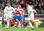 Real Madrid's Sami Khedira against Granada's Dani Benitez during La Liga Match. January 07, 2012. (ALTERPHOTOS/Alvaro Hernandez)