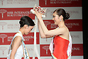 November 4, 2014, Tokyo, Japan - Arisa Nakagawa, 18-year-old college student, left, is crowned by Lila Hongo after winning the Miss International Japan 2015 in Tokyo on November 4, 2014. (Photo by AFLO)