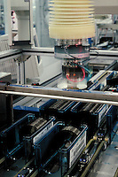Moving robotic equipment at hard disk drive computer manufacturing company, California. Technology. Factory. California.