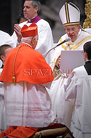 Chilean cardinal Ricardo Ezzati Andrello receives his beret as he is being appointed cardinal by Pope Francis  at the consistory in the St. Peter's Basilica at the Vatican on February 22, 2014.