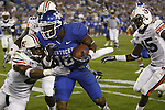 Running back / Wide Receiver Randall Cobb runs past an Auburn defender during the second half of UK's home game against Auburn, Oct. 9, 2010. Photo by Brandon Goodwin| Staff