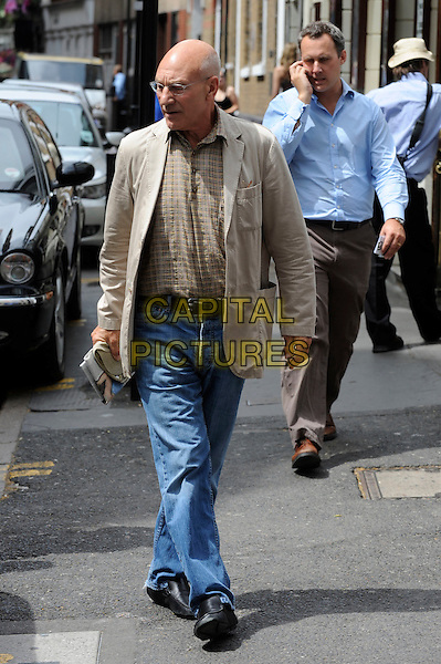 PATRICK STEWART .Spotted in Soho, London, England, UK, July 1st 2010..full length beige jacket shirt jeans denim glasses walking .CAP/IA.©Ian Allis/Capital Pictures.