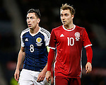 Scott Brown of Scotland with Christian Eriksen of Denmark during the Vauxhall International Challenge Match match at Hampden Park Stadium. Photo credit should read: Simon Bellis/Sportimage