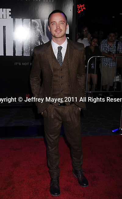 """UNIVERSAL CITY, CA - OCTOBER 10: Aaron Paul arrives to """"The Thing"""" Los Angeles Premiere at AMC Universal City Walk on October 10, 2011 in Universal City, California."""