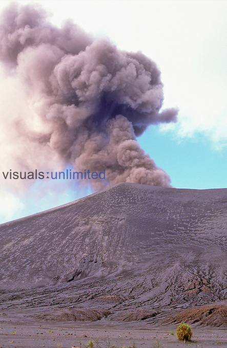Yasur Volcano on Tanna Island, Vanuatu with a cone of ash and lava and an erupting cloud of ash and gases.