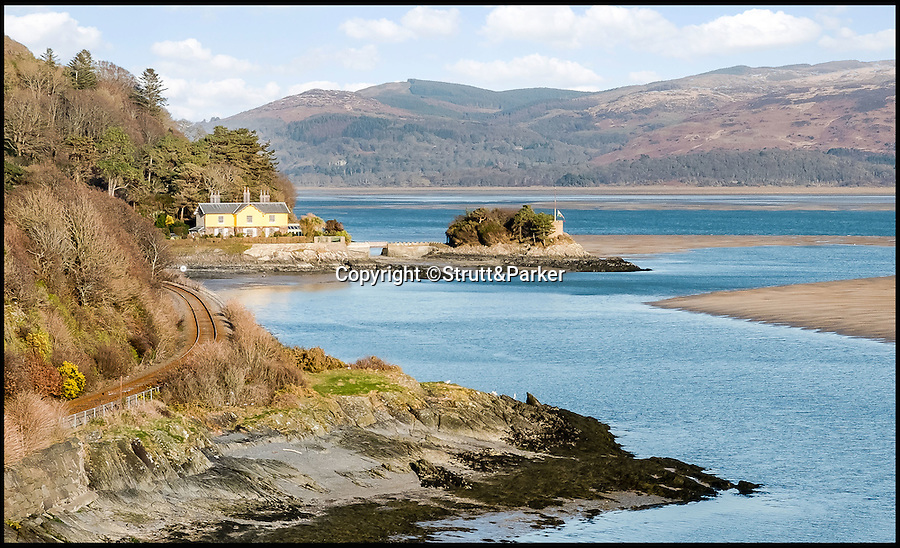 BNPS.co.uk (01202 558833)<br /> Pic: Strutt&Parker/BNPS<br /> <br /> Go West...ultimate coastal hideaway with its own private island.<br /> <br /> A beautiful family home with its own private island is the perfect purchase for anyone with a sense of adventure.<br /> <br /> Trefri Hall is a stunning Grade II listed house with the Snowdonian hills as a backdrop and incredible views over the Dovey Estuary in mid Wales.<br /> <br /> But the real selling point is the small rocky island you can reach by bridge with your own castellated folly - ideal for pirate games or a spot of hide and seek.<br /> <br /> The house is up for sale with Strutt & Parker for £1.75million.