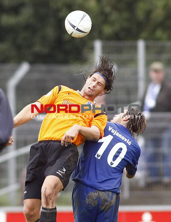 RLN 2007/2008 12. Spieltag Hinrunde<br /> BSV Kickers Emden -  1. FC Magdeburg<br /> Christian Presr (Magdeburg#3) - Radovan Vujanovic (Emden#10)<br /> Foto &copy; nph (  nordphoto  )<br /> <br /> <br /> <br />  *** Local Caption ***