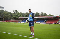 Goalkeeper Scott Brown of Wycombe Wanderers in the rain ahead of the pre season friendly match between Aldershot Town and Wycombe Wanderers at the EBB Stadium, Aldershot, England on 22 July 2017. Photo by Andy Rowland.