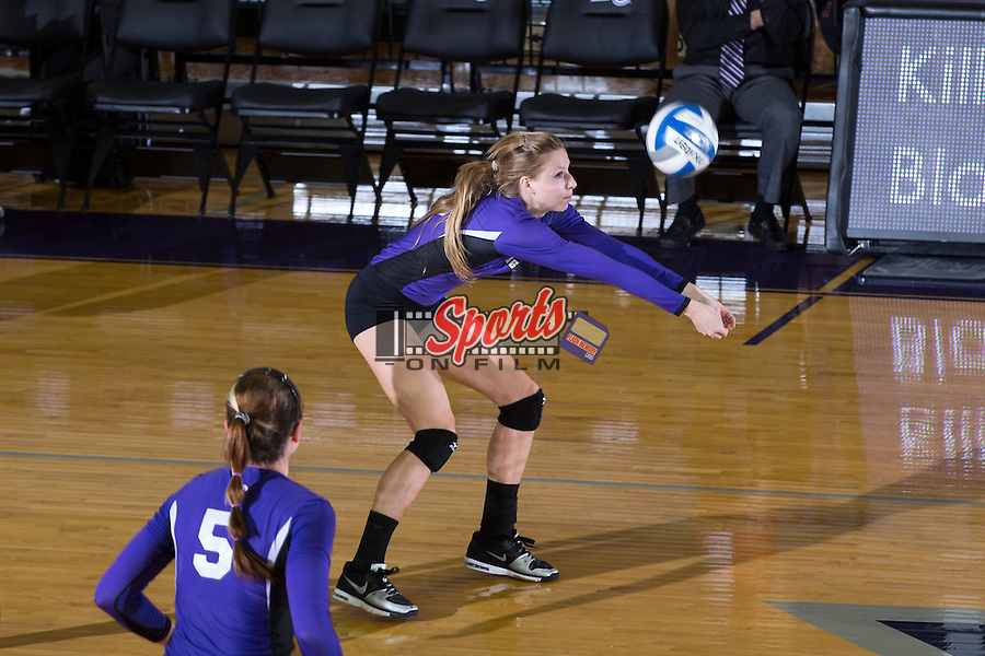 Chelsea Davis (16) of the High Point Panthers digs the ball against the UNC Greensboro Spartans at Millis Athletic Center on September 16, 2014 in High Point, North Carolina.  The Panthers defeated the Spartans 3-0.   (Brian Westerholt/Sports On Film)