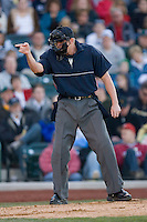 Home plate umpire Brandon Henson calls a strike during the Midwest League game between the Dayton Dragons and the Fort Wayne Tin Caps at Parkview Field April 16, 2009 in Fort Wayne, Indiana. (Photo by Brian Westerholt / Four Seam Images)