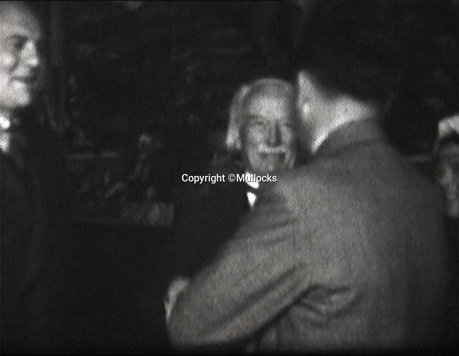 BNPS.co.uk (01202 558833)<br /> Pic: Mullocks/BNPS<br /> <br /> Lloyd George chats to Hitler at his home in the Bavarian alps.<br /> <br /> A remarkable film of David Lloyd George's visit to Germany to meet Adolf Hitler in 1936 after which he described him as 'the greatest living German' has emerged for auction.<br /> <br /> The unique black and white 16mm film which lasts 20 minutes shows former Prime Minister Lloyd George and his entourage twice meeting Hitler and driving along newly created autobahns.<br /> <br /> The grainy footage captures Lloyd George with Hitler at a dinner party, him laying a wreath at a war memorial in Munich and the alarming sight of the Nazi and United Kingdom flags hanging together on a German building.<br /> <br /> The film belongs to a British historian with a large collection of archive footage and is tipped to sell for £1,200.