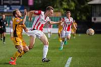 Sean Rigg of Newport County grabs the shorts of Daniel Parslow of Cheltenham during the Sky Bet League 2 match between Newport County and Cheltenham Town at Rodney Parade, Newport, Wales on 10 September 2016. Photo by Mark  Hawkins / PRiME Media Images.