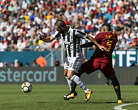 Foxborough, Massachusetts - July 30, 2017: First half action. In 2017 International Champions Cup (ICC United States) match, Roma (maroon) vs Juventus (black/white), at Gillette Stadium.