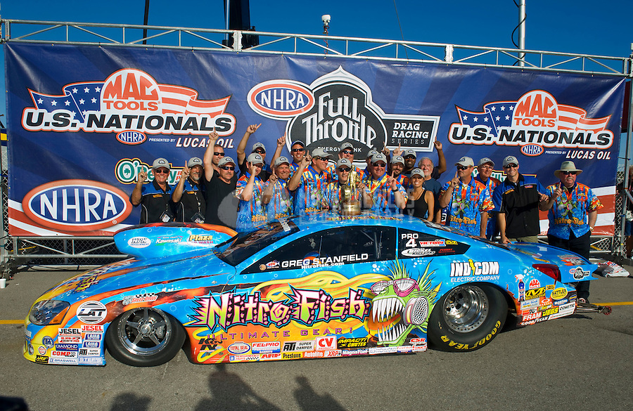 Sept. 6, 2010; Clermont, IN, USA; NHRA pro stock driver Greg Stanfield celebrates with his team after winning the U.S. Nationals at O'Reilly Raceway Park at Indianapolis. Mandatory Credit: Mark J. Rebilas-