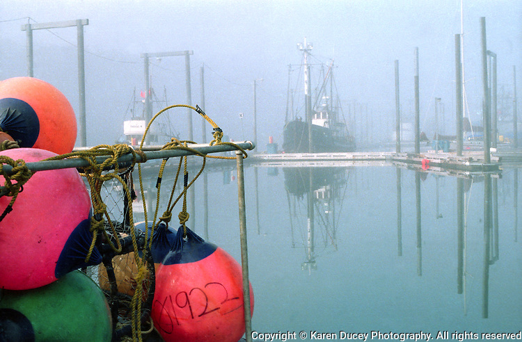 Buoys and a fishing boat on a foggy day in Dog Bay Harbor, Kodiak, Alaska