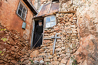 Mount Athos - The Holy Mountain.<br /> Father Arsenios by the entrance of his cell. He has not left there for 64 years as he is too old and frail now to climbs the cliffs which surround his cell.<br /> <br /> Photographer: Rick Findler