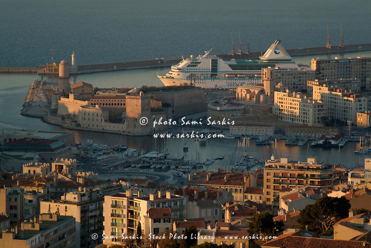 Saint Jean Fort and a ferry leaving the city viewed from Notre Dame de la Garde, Vieux-Port, Marseille, France.
