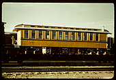 Side view passenger coach #280 on flatcar. Yellow with black stripe color scheme.<br /> D&amp;RGW