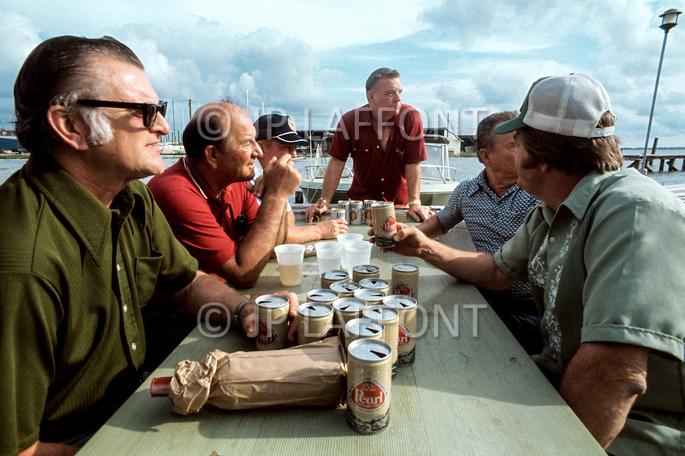 Houston, Texas - May 6, 1977. Red Adair has lunch with employees. Red Adair (June 18, 1915 - August 7, 2004) was an American oil well firefighter, who later became an innovator in the highly specialized profession of extinguishing and capping blazing or erupting oil well blowouts, both on land and offshore.