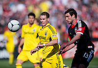 Chris Pontius (13) of D.C. United fights for the ball with Josh Williams (3) of the Columbus Crew during the game at RFK Stadium in Washington, DC.  Columbus Crew defeated D.C. United, 2-1.