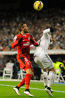Real Madrid´s Jese Rodriguez and Sevilla's Coke during 2014-15 La Liga match between Real Madrid and Sevilla at Santiago Bernabeu stadium in Alcorcon, Madrid, Spain. February 04, 2015. (ALTERPHOTOS/Luis Fernandez) /NORTEphoto.com