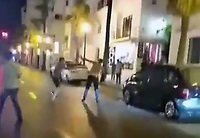 TWO men turn the upmarket holiday resort of Puerto Banus into a fight club in an extraordinary street battle behind the glamorous Spanish port Popular British holidaymakers.<br /> Stunned Tourists filmed the violence on their mobile phones as the pair laid into each in the middle of the main road running along the back of the port near the multi-million pounds yachts and high-powered sports cars lined along the marina.<br /> The two men, one bare chested, whipped their belts off to use as weapons before crashing to the tarmac after a vicious punch-up and continuing their fight on the floor.<br /> Just when the brawler with no T-shirt on got the upper hand after getting his rival in a headlock and started smashing his fists into his face, the other managed to reverse the positions and get on top.<br /> Only a couple of the stunned onlookers tried to stop the violence, with most opting instead to record the scene on their mobile phones.<br /> This pic:Street fitting in Puerto Banus<br /> 28.07.2017