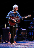 Graham Nash on acoustic guitar.  David Crosby and  Graham Nash  at the Neal S. Blaisdell Center in Honolulu, HI, with James Raymond on keyboards and Shane Fontayne on lead guitar.