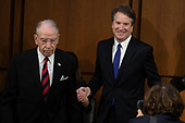 Judge Brett Kavanaugh, right, led by Committee Chairman Senator Chuck Grassley, Republican of Iowa, left, arrives prior to a hearing before the United States Senate Judiciary Committee on his nomination as Associate Justice of the US Supreme Court to replace the retiring Justice Anthony Kennedy on Capitol Hill in Washington, DC on Tuesday, September 4, 2018.Credit: Alex Edelman / CNP
