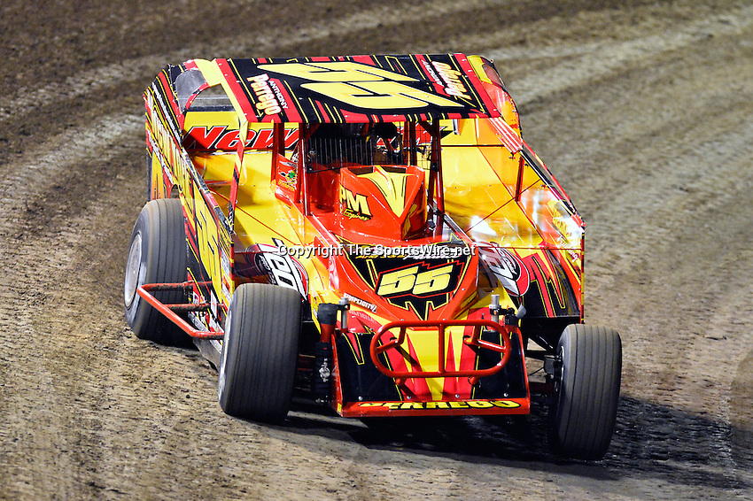 Feb 19, 2014; 6:44:55 PM;  Barberville, FL, USA;  Super DIRT car Series Big Block Modifieds presented by Summit Racing Equipment at Volusia Speedway Park.  Mandatory Credit: (thesportswire.net)