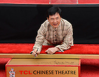 HOLLYWOOD, CA - JUNE 06: Jackie Chan Hand and Foot Print Ceremony at the TCL Chinese Theatre on June 6, 2013 in Hollywood, California.