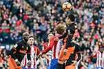 Atletico de Madrid's Antoine Griezmann and Valencia CF's Eliaquim Mangala and Fabian Orellana during La Liga match between Atletico de Madrid and Valencia CF at Vicente Calderon Stadium  in Madrid, Spain. March 05, 2017. (ALTERPHOTOS/BorjaB.Hojas)