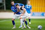 St Johnstone v Inverness Caley Thistle...15.10.11   SPL Week 11.Graeme Shinnie is held by Marcus Haber.Picture by Graeme Hart..Copyright Perthshire Picture Agency.Tel: 01738 623350  Mobile: 07990 594431