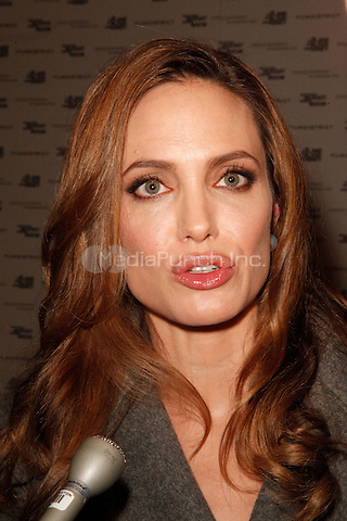 Angelina Jolie at the 'In the Land of Blood and Honey' premiere at the United States Holocaust Memorial Museum on January 10, 2012 in Washington, DC. © Star Shooter/MediaPunch Inc.