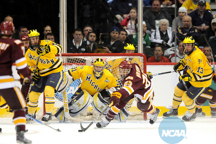 09 APR 2011: Minnesota Duluth forward J.T. Brown (23) tries to get the puck on his stick against the Michigan Wolverines in the first period during the Division I Men's Ice Hockey Championship held at the Xcel Energy Center in St. Paul, MN.  Minnesota-Duluth beat Michigan in overtime, 3-2 to claim the national title. Vince Muzik/ NCAA Photos