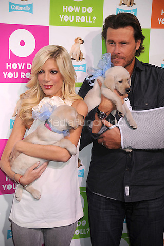 Tori Spelling and Dean McDermott celebrate Thomas Crapper Day at ABC Studios in New York City. January 27, 2010. Credit: Dennis Van Tine/MediaPunch
