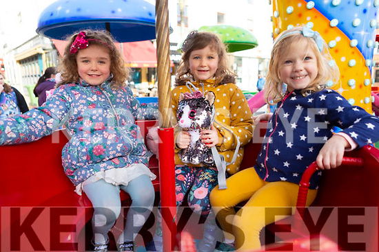 Ava and Edith Boyle and Cara Nugent from Tralee enjoying the amusements at the Lion & Dragon Ritual for the Chinese New Year celebrations in the square in Tralee on Saturday.