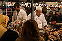 Men cooking on a food stall in Djemaa el-Fna, Marrakech, Morocco.