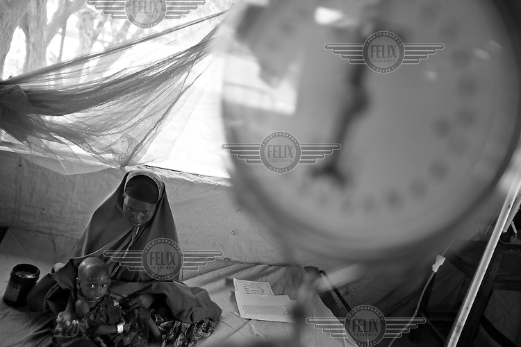 A MSF (Doctors Without Borders) feeding centre in Dadaab refugee camp in northern Kena near the Somali border aids families escaping from drought in Somalia.   Thousands face starvation in what could be the Horn of Africa's worst drought in 50 years. Dadaab Refugee Camp, Kenya. Photo Robin Hammond/Panos. July 2011
