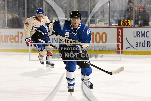 Lake Erie Monsters defensemen Brett Clark (5) skates up ice during the first period of The Frozen Frontier outdoor AHL game against the Rochester Amerks at Frontier Field on December 13, 2013 in Rochester, New York.  (Copyright Mike Janes Photography)