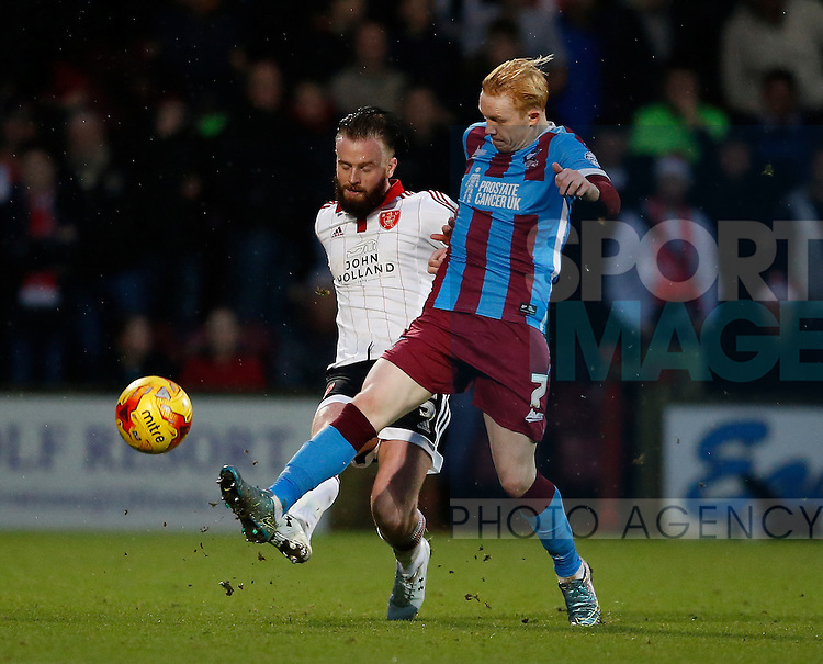 John Brayford of Sheffield Utd tussles with Luke Williams of Scunthorpe Utd - English League One - Scunthorpe Utd vs Sheffield Utd - Glandford Park Stadium - Scunthorpe - England - 19th December 2015 - Pic Simon Bellis/Sportimage