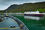 Alaska Marine Highway System approaching to Port of Juneau. Kennicott Ferry docked at the terminal.