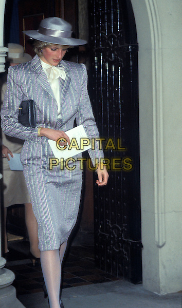 HRH, THE PRINCESS DIANA OF WALES.London, England..Lady Di family her royal highness half 3/4 length grey and white pinstripe suit hat striped bow neck tie scarf.Ref: CAP/PL.©Phil Loftus/Capital Pictures