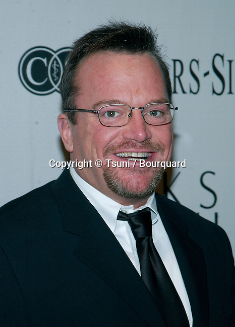 Tom Arnold arriving at the benefit for the Cedars Sinai research for Women's Cancer at the Regent Beverly Wilshire in Los Angeles. March 26, 2002.
