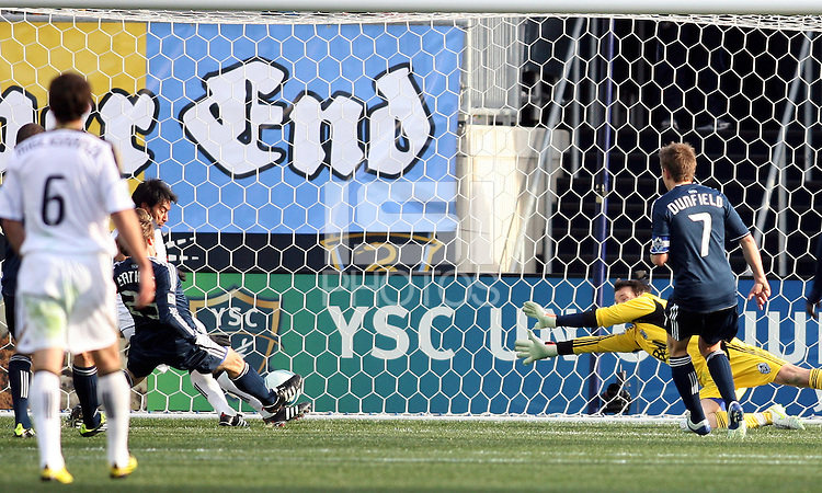 Carlos Ruiz#20 of the Philadelphia Union beats Jonathan Leathers#25 and Joe Cannon#1 of the Vancouver Whitecaps to score the winning goal during an MLS match at PPL Park in Chester, PA. on March 26 2011. Union won 1-0.