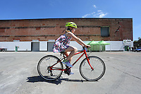 Pictured: Emily Lawson, the daughter of the owners, tests a bike Monday 15 August 2016<br />
