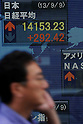 September 9th, 2013 : Tokyo, Japan - A man walked by a stock quotation board at Yaesu, Chuo, Tokyo, Japan on September 9, 2013. Nikkei Stock Average climbed due to several reasons, such as Tokyo that was selected to host the 2020 Olympics and Paralympics.  (Photo by Koichiro Suzuki/AFLO)